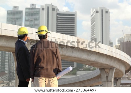 businessman hand working with new big city background and business strategy as concept  - stock photo