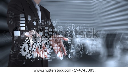 businessman hand working with new modern computer and business strategy gear to success as concept  - stock photo
