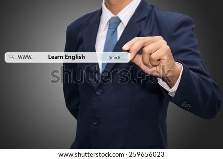 Businessman hand write a Learn English  - stock photo