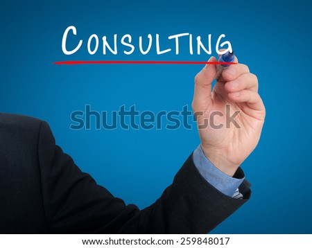 Businessman hand writing Consulting. Consult sign for business. Blue - stock photo
