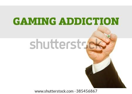 Businessman hand writing Gaming Addiction isolated on white. - stock photo