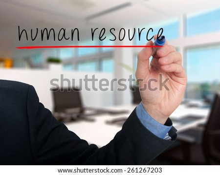 Businessman hand writing Human Resource in the air. Office - Stock Photo - stock photo