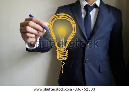 businessman hand writing light bulb, business idea,business concept - stock photo