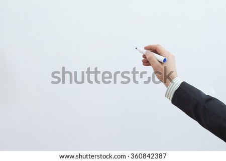 businessman hand writing on the whiteboard - stock photo