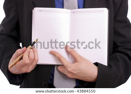 Businessman handing an open book - stock photo