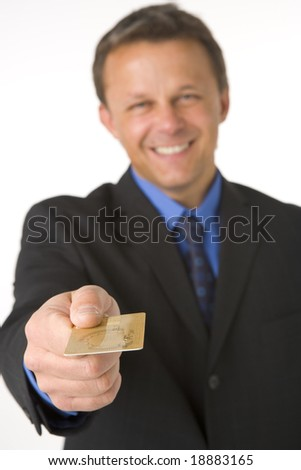 Businessman Handing Over Gold Credit Card - stock photo