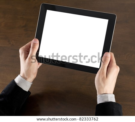 Businessman hands are holding the touch screen device. - stock photo