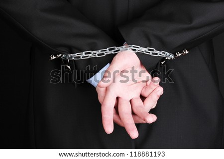 Businessman hands fettered with chain - stock photo