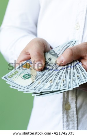 businessman hands holding dollar cash - business, people, finances and money concept - stock photo