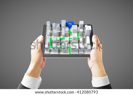 Businessman hands holding mobile device with 3D navigator on grey background - stock photo