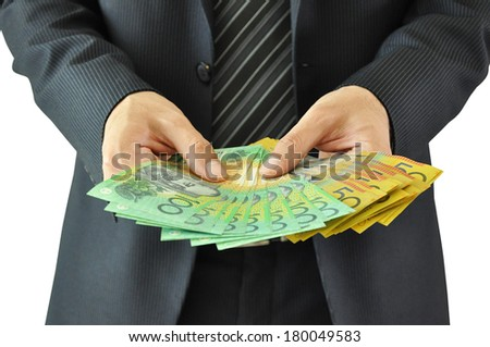 Businessman hands holding money  - Australian dollar bills - stock photo