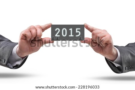 businessman hands holding object board with number 2015  isolated on white background. High resolution  - stock photo