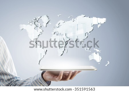 Businessman hands holding tablet with world map on screen - stock photo