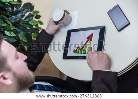 businessman hands on the table, growth chart, success - stock photo