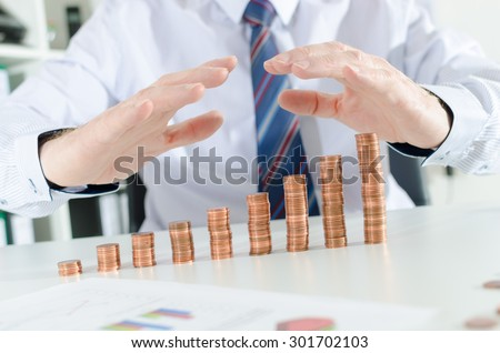 Businessman hands protecting money - stock photo