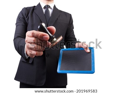 businessman hands put the stamp blackboard on white background with clipping path  - stock photo