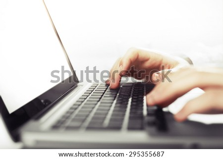 businessman hands working on laptop, close up - stock photo
