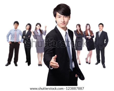 businessman handshake, hold hand welcome gesture, Handsome young business man happy smile shake hand over group of businesspeople background, asian model - stock photo