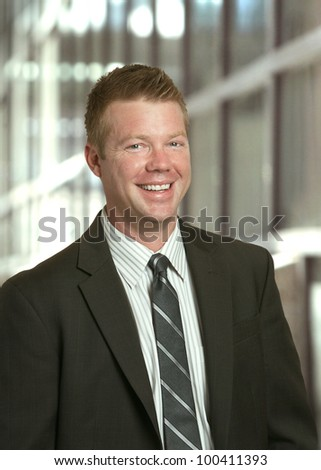Businessman handsome laughing smiling man - stock photo