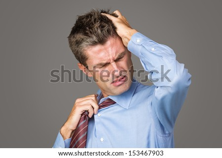 businessman has a headache - stock photo