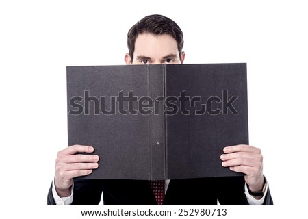 Businessman has covered his face with folder - stock photo