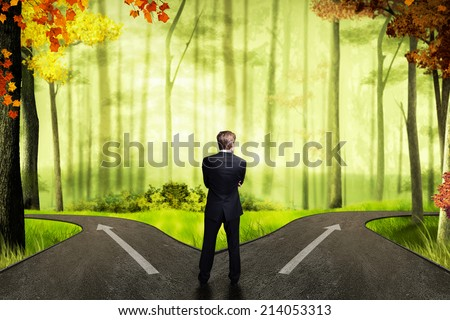 businessman has to decide which direction is better  - stock photo