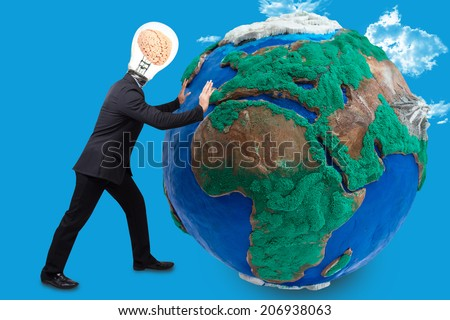 businessman have brain inside a light bulb pushing big earth planet urban scene balcony over looking city dusky before rain falling conceptual business team working cohesively Interaction and unity - stock photo