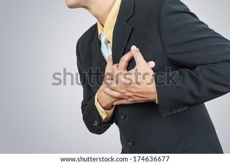 businessman having heart attack - stock photo