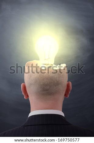 businessman having that big idea moment - stock photo