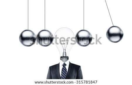 businessman head lamp and metal pendulum - stock photo