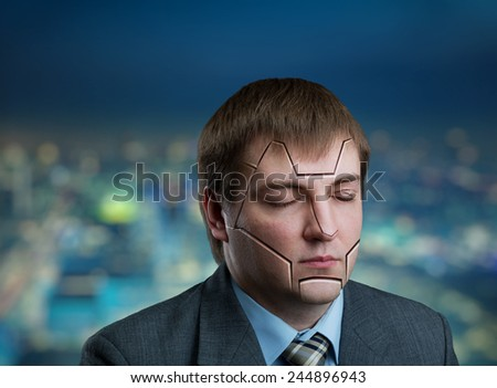 Businessman head with cracks on his face - stock photo