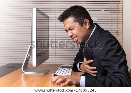 Businessman Heart Attack in office - stock photo