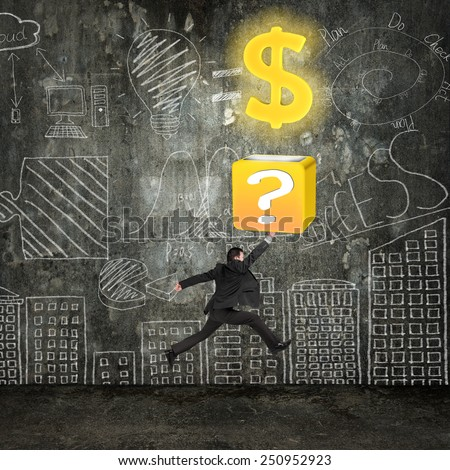 Businessman hit question mark box opening glowing golden dollar sign with business concept doodles wall - stock photo