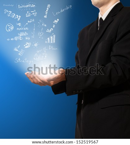 businessman hold concept of business in air - stock photo