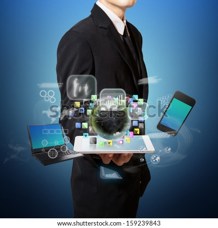 businessman hold connection of technology on tablet - stock photo