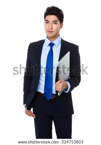 Businessman hold with laptop computer - stock photo
