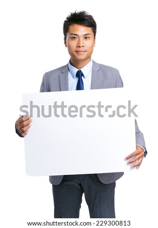 Businessman hold with white board - stock photo