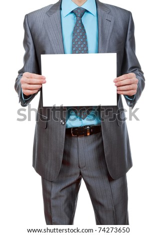 businessman holding a blank white board, signboard, showing an emty bill board against white background - stock photo