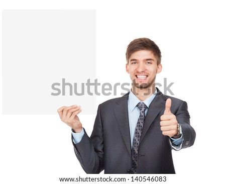 businessman holding a blank white card board, signboard, thumb up finger gesture, empty bill board, handsome young business man happy smile, isolated over white background - stock photo