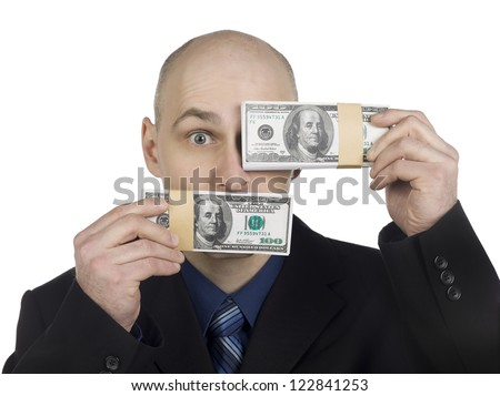 Businessman holding a bundle of money and covering his one eye using a paper currency - stock photo