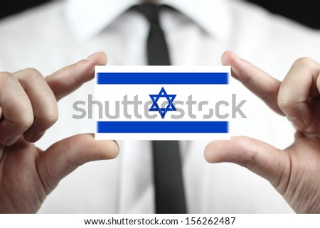 Businessman holding a business card with a Israel Flag - stock photo