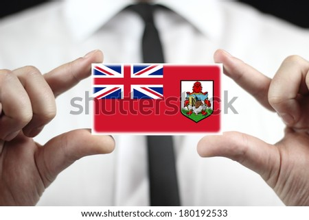 Businessman holding a business card with Bermuda Flag - stock photo