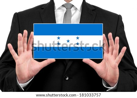 Businessman holding a business card with Honduras Flag - stock photo