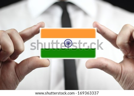Businessman holding a business card with India Flag - stock photo