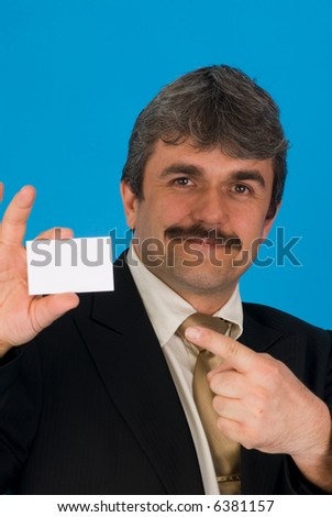 businessman holding a businesscard - stock photo