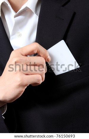Businessman Holding a Card out of his suit pocket - stock photo