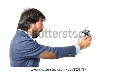 Businessman holding a clock over white background - stock photo