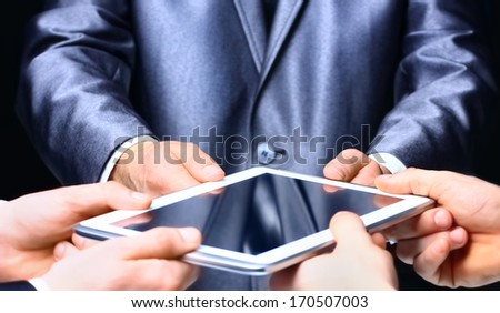 Businessman holding  a digital tablet. Close up. - stock photo