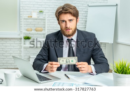 Businessman holding a dollar - stock photo