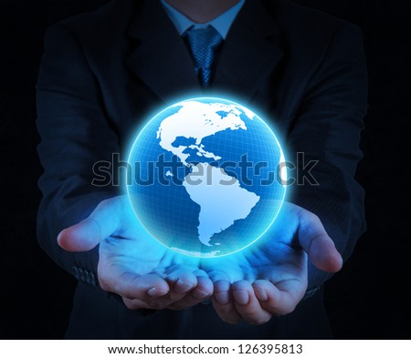 businessman holding a glowing earth globe in his hands - stock photo